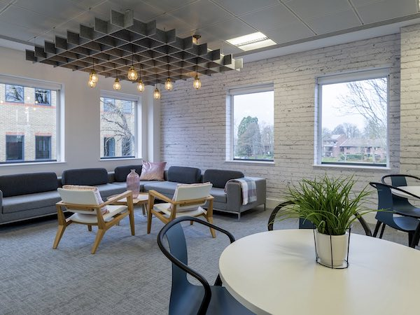 IFS seating room decorated with white exposed brick