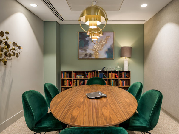 LJ Partnership board room painted in white with light green feature wall