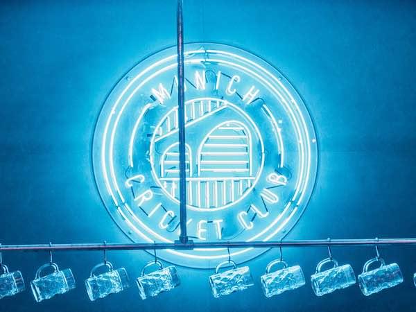 Munich Cricket Club blue neon sign