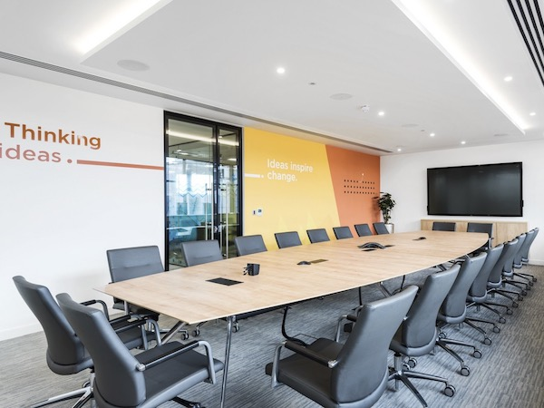 PSA Finance boardroom painted in white with wallpaper feature wall