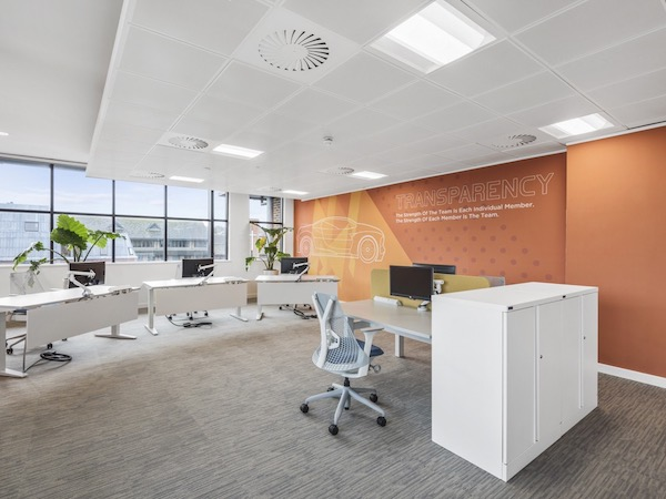 PSA Finance meeting room decorated with orange wallpaper